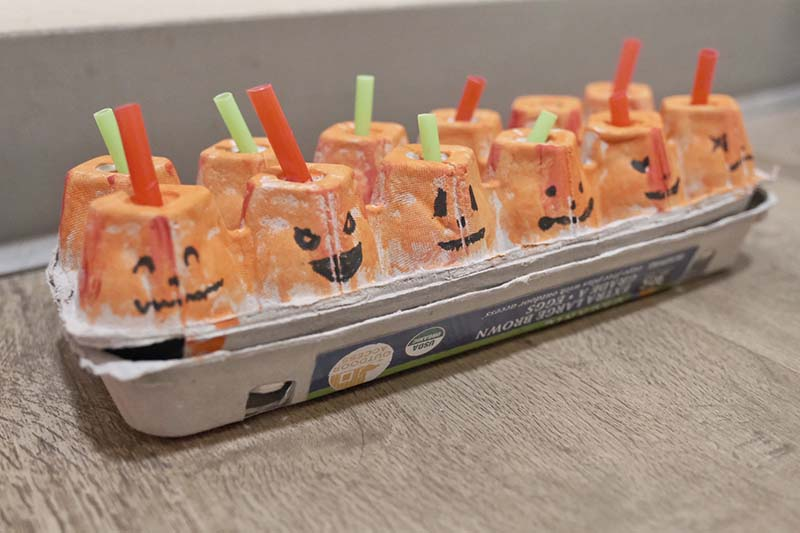 Egg Crate Pumpkin Straw Posting Activity for Toddlers