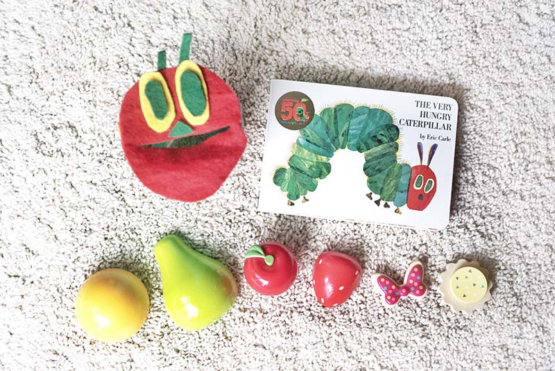 Trying the Hungry Caterpillar Feeding Toddler Activity