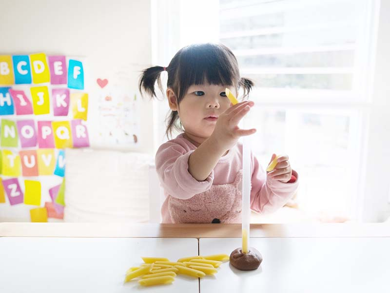 Pasta Drop Fine Motor Activity for Young Toddlers