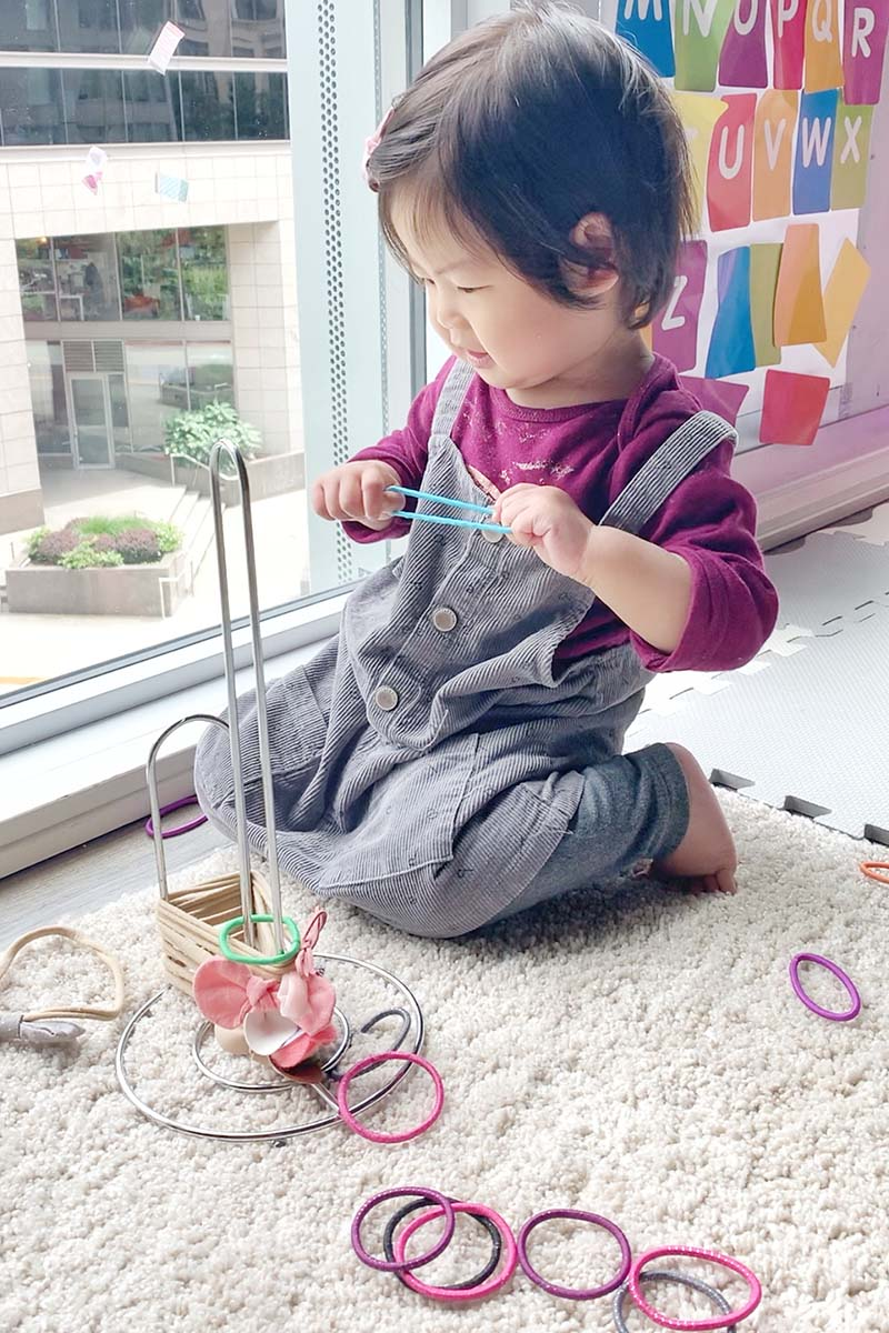 Trying Out Looping Hair Ties Toddler Activity
